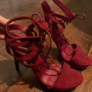 GUESS red lace up heel. never worn.